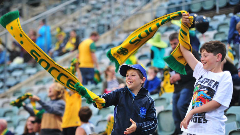 From left, Johnny Frilingos,10 of Chifley and Luca Brancella of Kambah at GIO Stadium in Canberra to see the Socceroos take on Kyrgyzstan in the World Cup qualifier.
