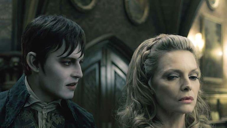 Johnny Depp and Michelle Pfeiffer in <em>Dark Shadows</em>..