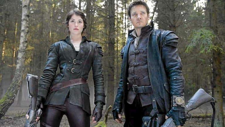 Gemma Arterton and Jeremy Renner in <i>Hansel & Gretel: Witch Hunters</i>.