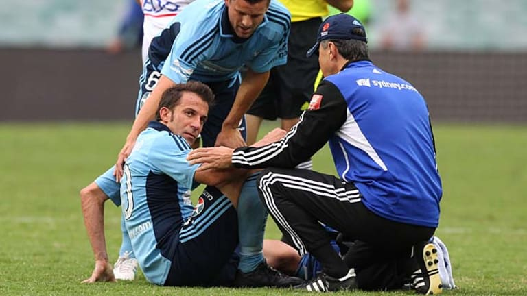 Down and out … Alessandro Del Piero feels the pain as a concerned Jason Culina looks on in Sydney's FC's scoreless draw with Melbourne Heart at the weekend.