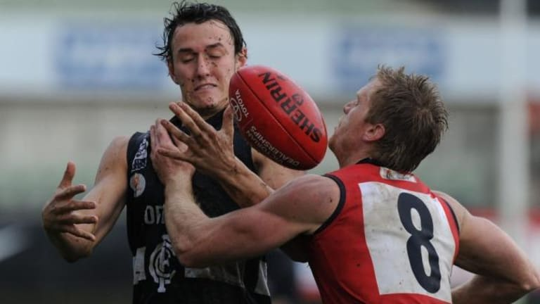 Ball up: Jarryd Coulson of the Blues attempts to mark as Casey's Troy Davis moves in.