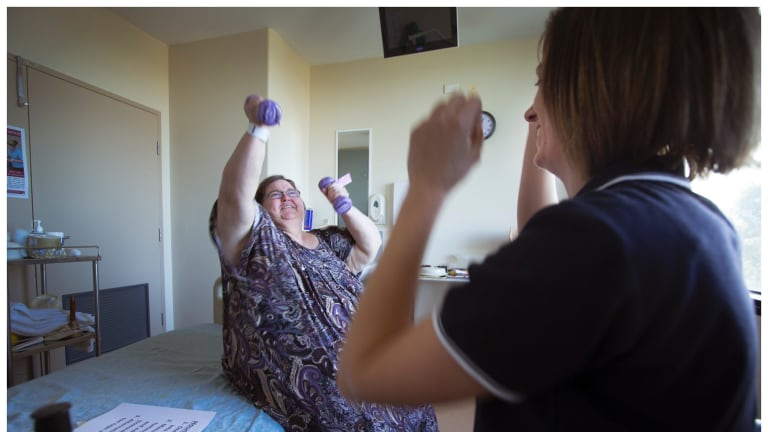 Lynne Weston doing exercises with physiotherapist Kelsey Evans.