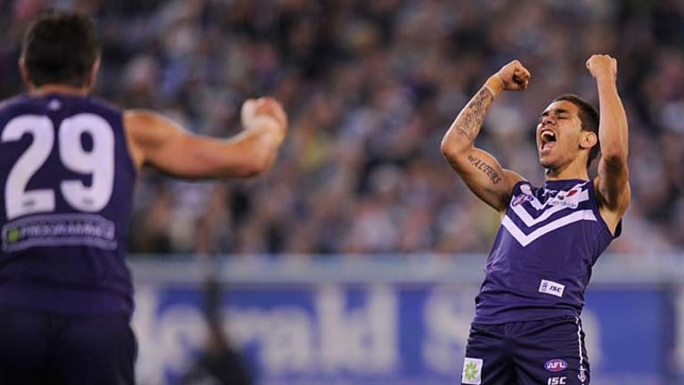 Purple haze ... Michael Walters celebrates one of his two goals.