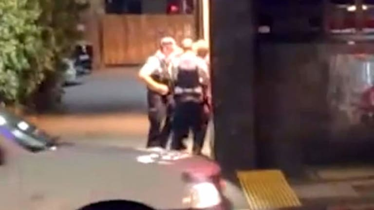 Police arrest a man outside a Fortitude Valley nightclub.