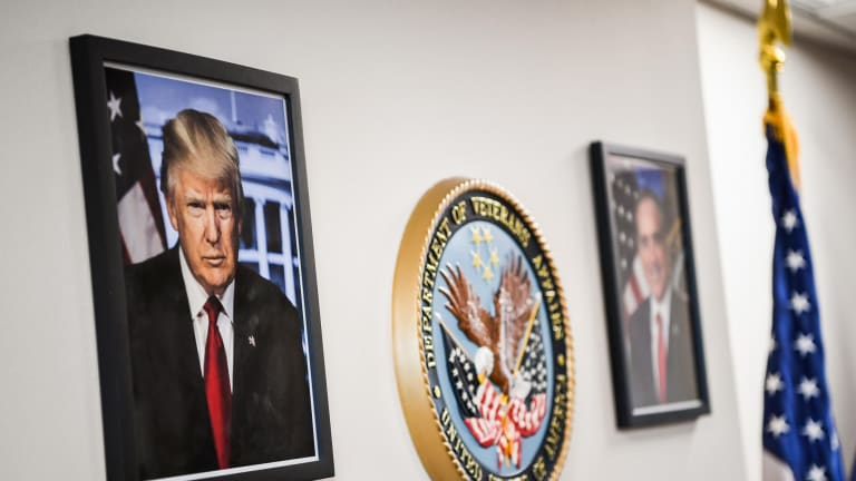 A framed portrait of President Trump - downloaded from the White House website - hangs in the lobby of the Department of Veterans Affairs offices in Washington.