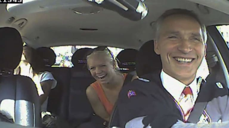 Norwegian Labour Party shows Norwegian Prime Minister Jens Stoltenberg (right) acting as a taxi driver in Oslo, Norway as a part of the election campaign.