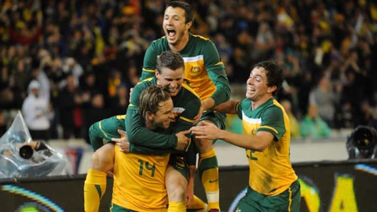 Brett Holman [14] celebrates with teammates  Nikita Rukavytsa, Jason Culina and Tommy Oar after scoring against New Zealand in May.