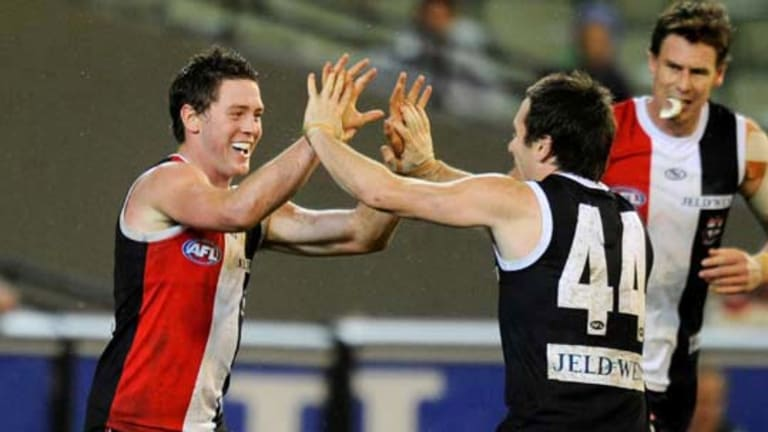 Jack Steven (left) is congratulated by Stephen Milne after one of his third-quarter goals.