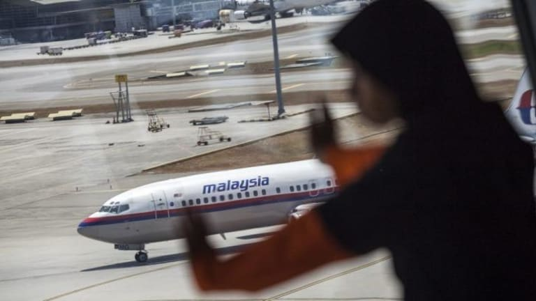 Missing Malaysia Airlines jet: search turns to Indian Ocean amid confusion over radar