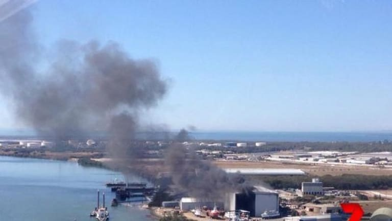 A boat goes up in flames at Hemmant, east of Brisbane.