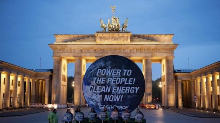 Members of Greenpeace at the Brandenburg Gate in Berlin.
