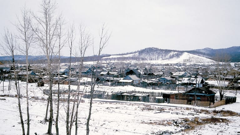 A view of Siberian countryside from the Trans-Siberian train in winter.