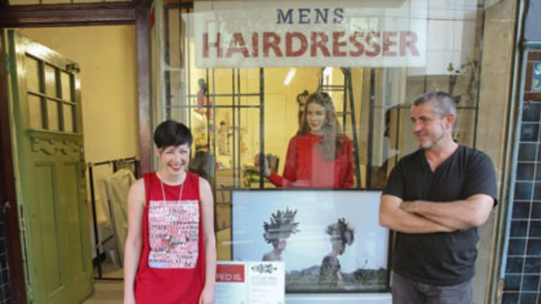 Hair razing ... festival curators Robyn Wilson and Michael Joyce, with artist Rose Vickers and one of her photos behind them.