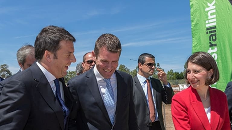 Italian Prime Minister Matteo Renzi, NSW Premier Mike Baird and Minister for Transport Gladys Berejiklian inspect the sky train works.