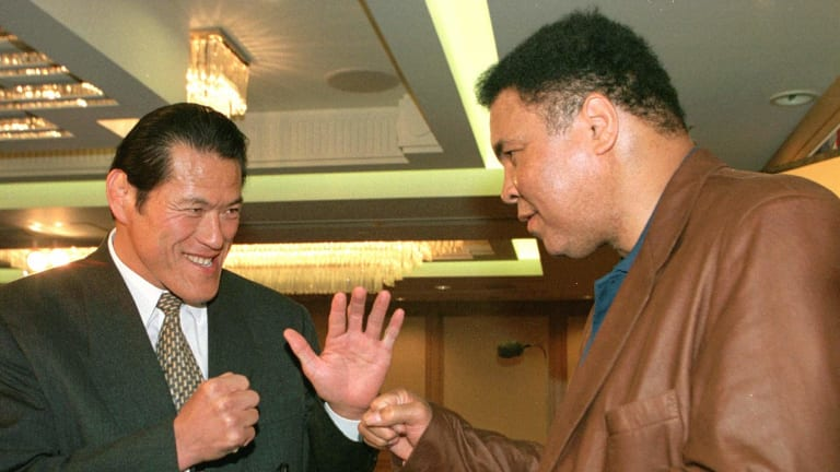 Reunion: Antonio Inoki, left, and Muhammad Ali meet again in Tokyo in 1998.