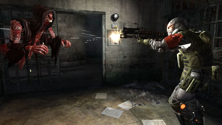 Confronting a ghoul in upcoming shooter F.E.A.R. 3