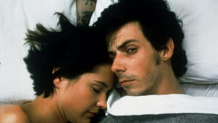 Emily Hamilton and Noah Taylor in the 2001 film of Birmingham's <i>He Died With A Felafel in his Hand</i>.