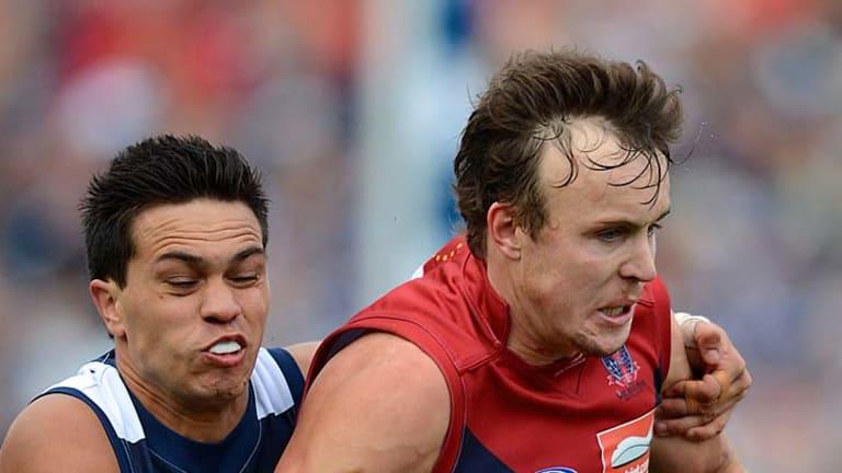 Geelong's Allen Christensen tackles Clint Bartram.