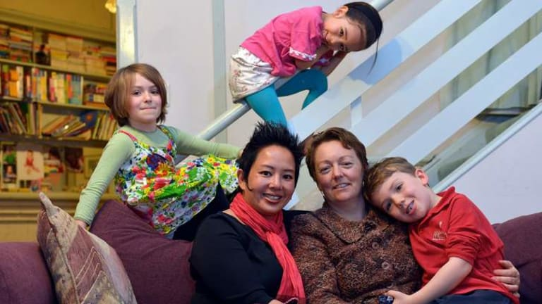 Kate Coghlan (left) and  Susan Rennie with their children Hannah, 8, Anouk, 5, (top) and Xavier, 6.