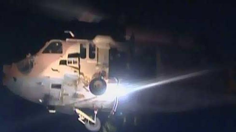 An Israeli helicopter flies over the Turkish aid ship Mavi Marmara.