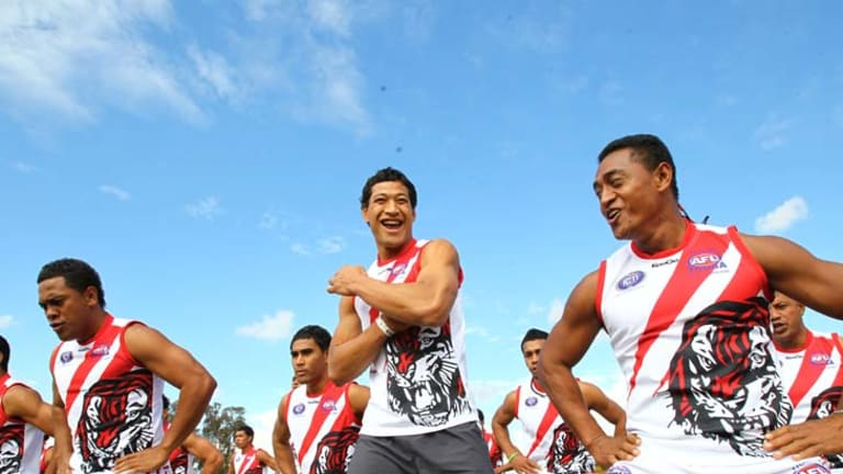 Land of the Giants ... Israel Folau joins the Tongan AFL team, which includes Folau's cousin Peni Mahina, at Doonside.
