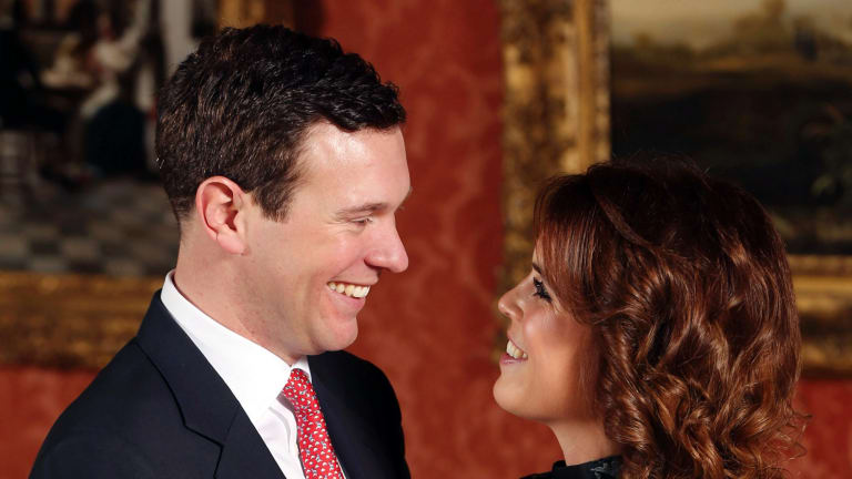 Britain's Princess Eugenie and Jack Brooksbank pose for the media at Buckingham Palace.