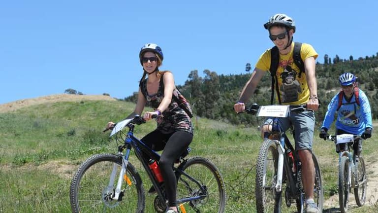 Human Brochure participants visit Stromlo Forest Park and a taste of the mountain bike track. English visitors, currently studying and living in Adelaide are 21 year old Sarah Wills and 20 year old Anthony Braybrooke. They are accompanied by paralympian, Michael Milton at rear.