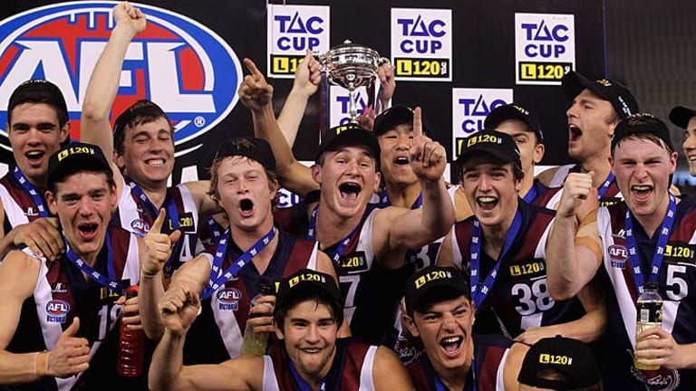 The Sandringham Dragons with their trophy after the TAC Cup grand final.