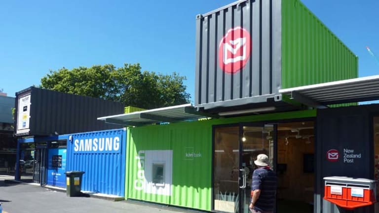 Makeshift mall … shipping containers have been pressed into service as shops.