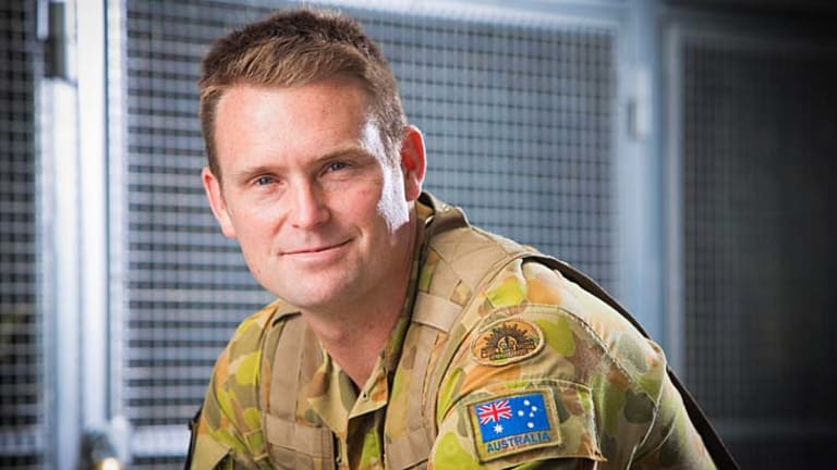 Former Former Brisbane Roar defender Andrew Packer is now among the ranks of the defenders of a nation.
