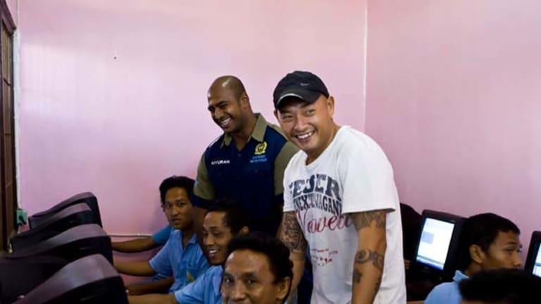 Helping others ... Myuran Sukumaran, left, and Andrew Chan with inmates in Kerobokan prison's computer room.