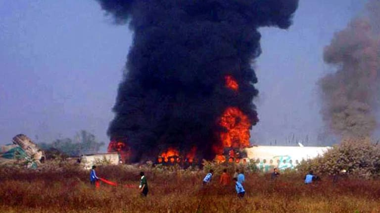 Deadly impact … flames rise from the wreckage.