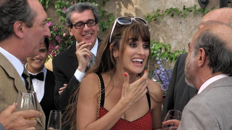 Screen siren … call girl Anna (Penelope Cruz) talks to clients in <i>To Rome with Love</i>.