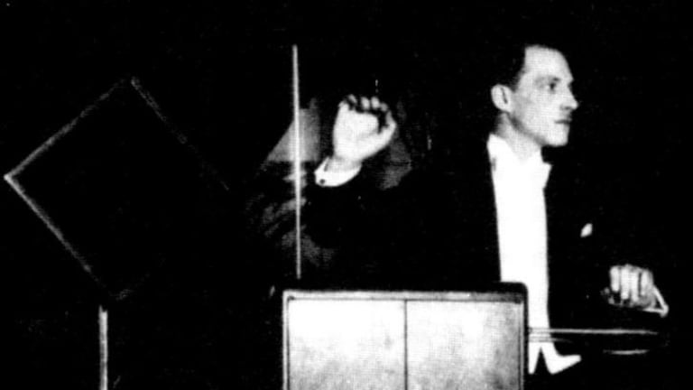 Leon Theremin with a theremin, an early electronic musical instrument.