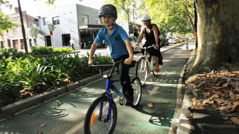 Safe conduit: A family on the cycle way on Sydney's Bourke Street.