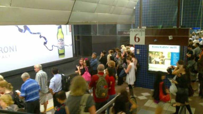 Crowds gather in Brisbane's Central Station in a bid to flee the CBD.