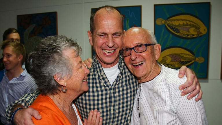 Welcome home son ... Australian journalist Peter Greste is hugged by his mother Lois, left, and father Juris, right, after his arrival in Brisbane.