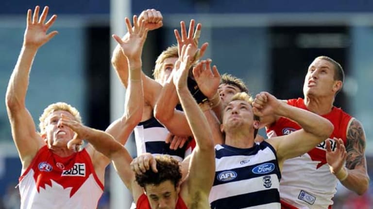 A big pack sets itself for a mark in yesterday's match between Geelong and Sydney at Skilled Stadium, won convincingly by the Cats.