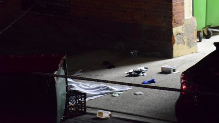 Marcus Volke's body lies covered with a blanket in Dath St, Teneriffe.