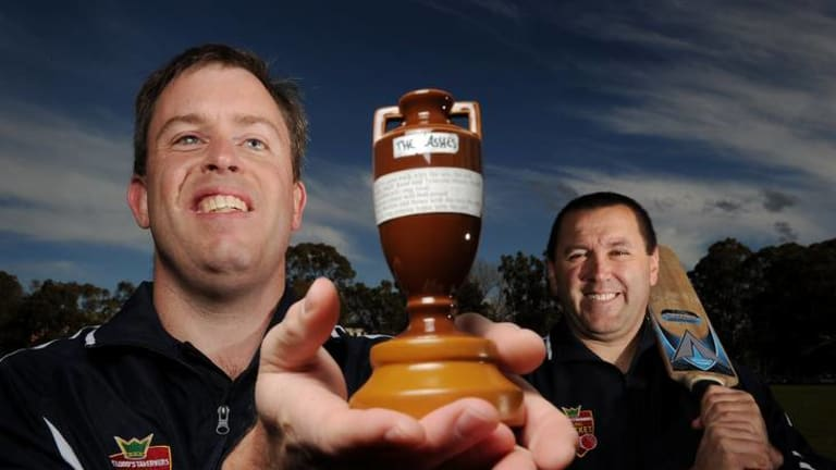 Canberra blind cricketers Cameron Roles, left, and Nick Haydar show off the Ashes urn, which they were allowed to bring back to Australia.