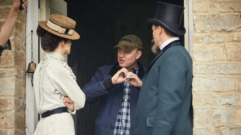 Keira Knightley with director Wash Westmoreland and Dominic West on the set of Colette.