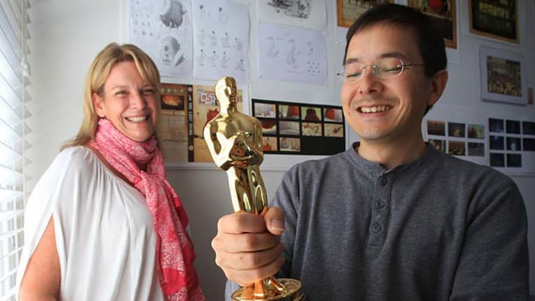 Golden time: Shaun Tan and producer Sophie Byrne with the statue that could keep them busy for years.