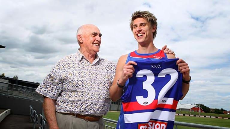 Family affair: Footscray premiership player Harvey Stevens with his grandson Michael Talia, a Western Bulldogs recruit.