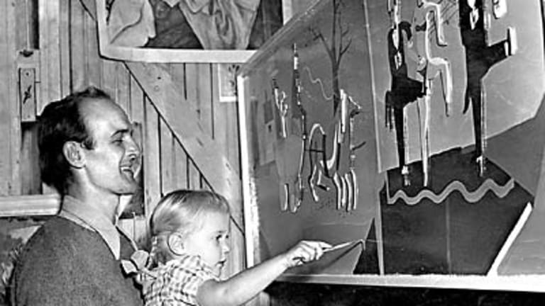 ``Little sibling of the brush''... Jane Olsen aged about four being taught to paint by her father John.