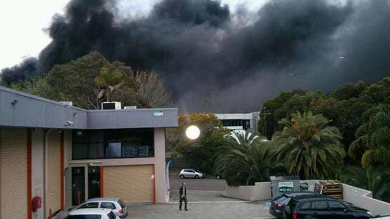 Smoke rises in Mona Vale after a fatal crash involving a fuel tanker.