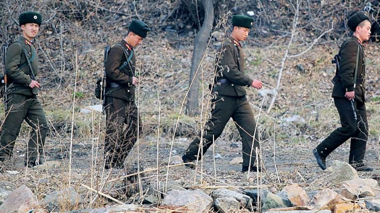 North Korean soldiers patrol along the bank of the Yalu River in the North Korean town of Sinuiju across from the Chinese city of Dandong.