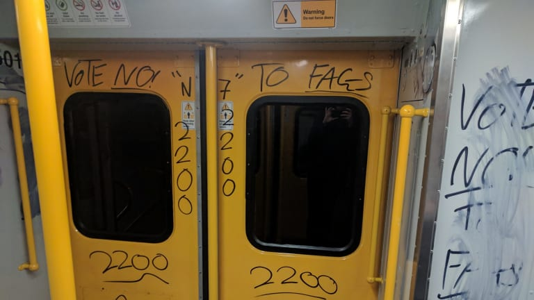 """""""Vote no to fags"""": A train carriage in Sydney was vandalised with homophobic graffiti."""
