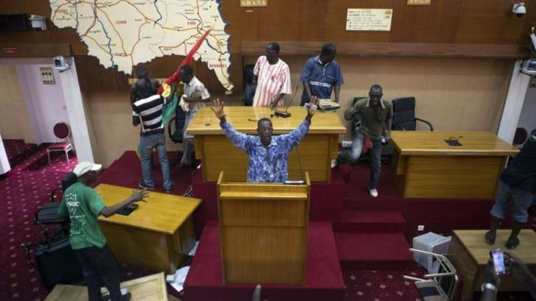 Taking control: Protesters inside the Burkina Faso parliament.