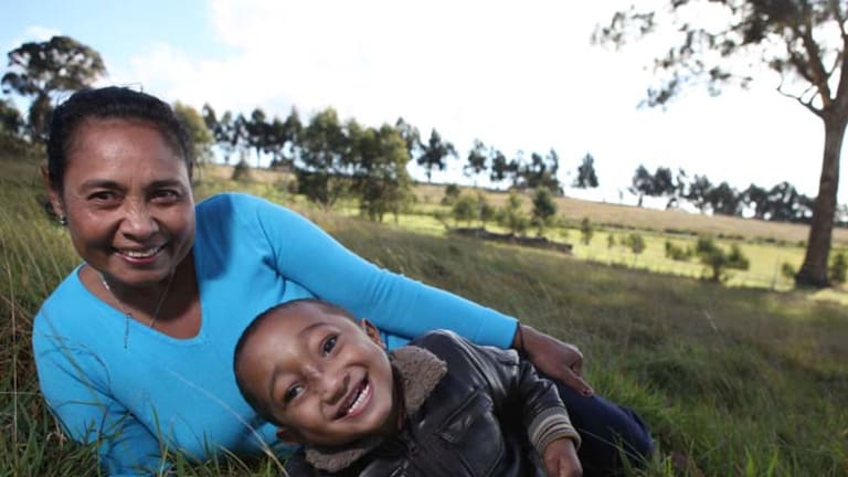 Overjoyed: Elsa Sanchez and her son Martinho at the Children First Foundation's farm in Kilmore yesterday.