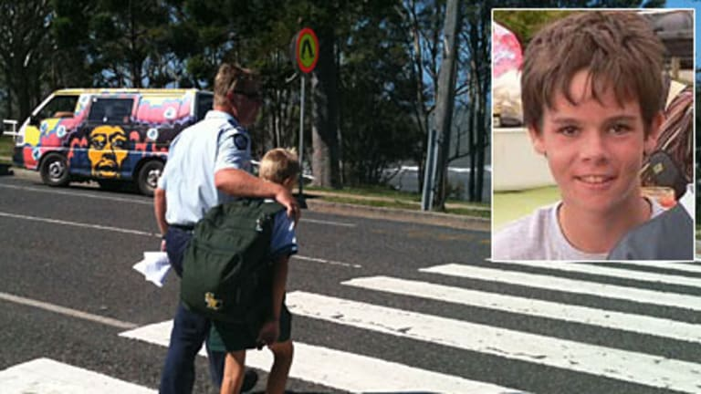 Distraught students were picked up early from St Patrick's College after 12yo Elliott Fletcher (inset) died of stab wounds.